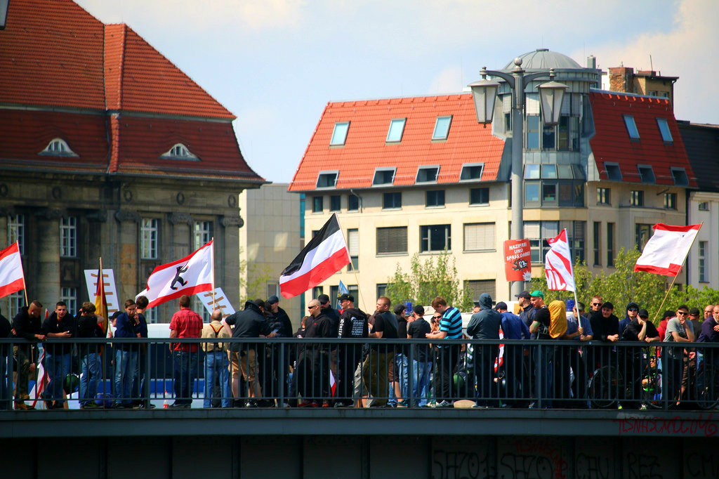 Anti-Nazi demonstrators in Berlin block a demonstration by the right-wing extremist National Democratic Party of Germany (NPD). April 2014 [Mike Herbst/Flickr]