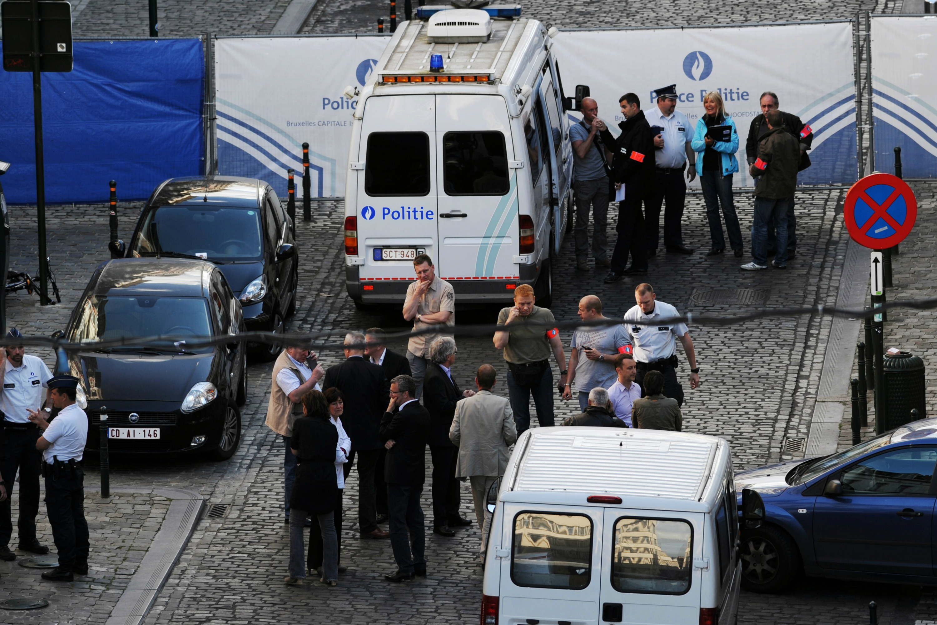 Police personnel are seen at the site of a shooting in front of the Jewish museum
