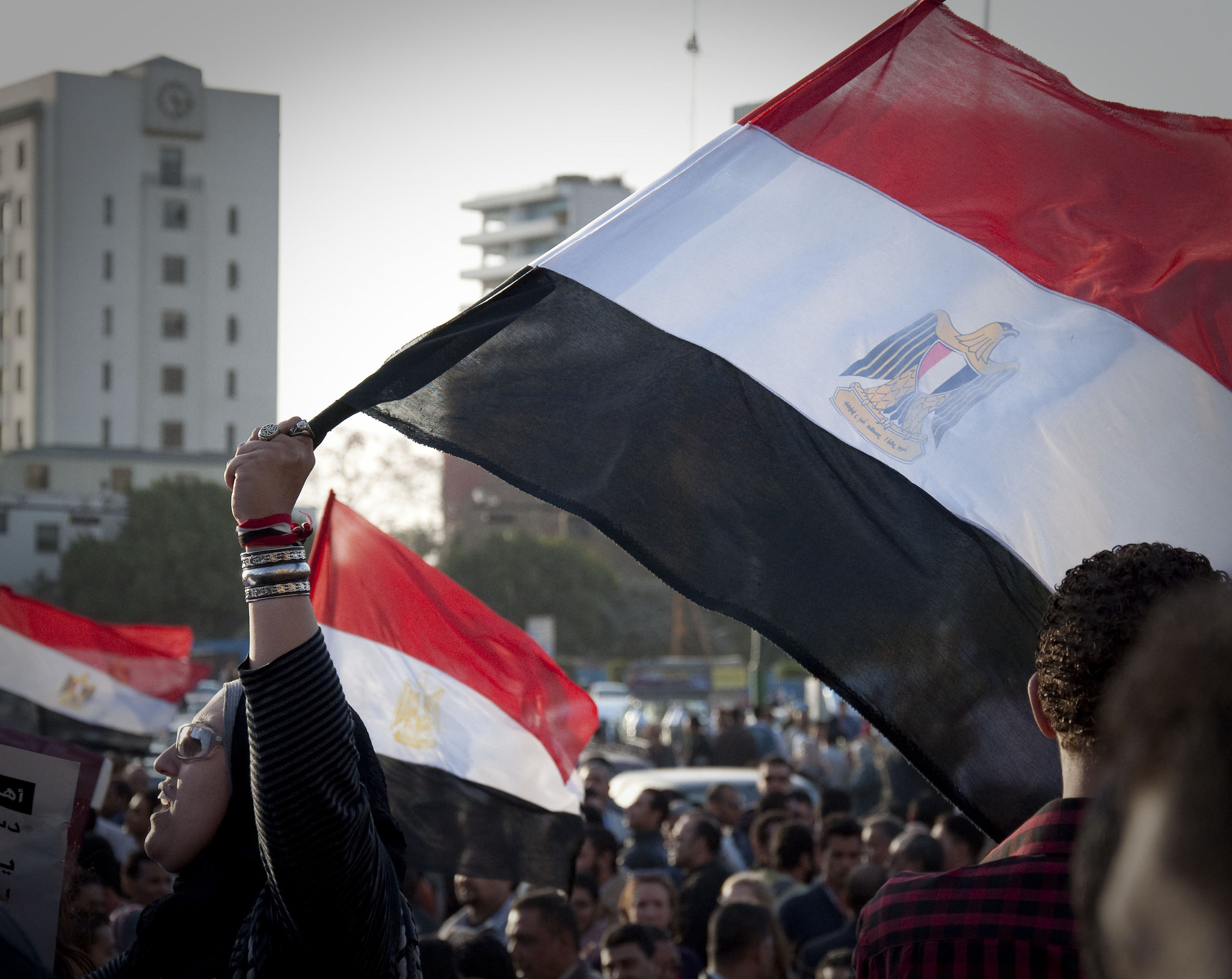 Woman protesting on Tahrir Square in Cairo, Egypt [UN Women Rights/Flickr]