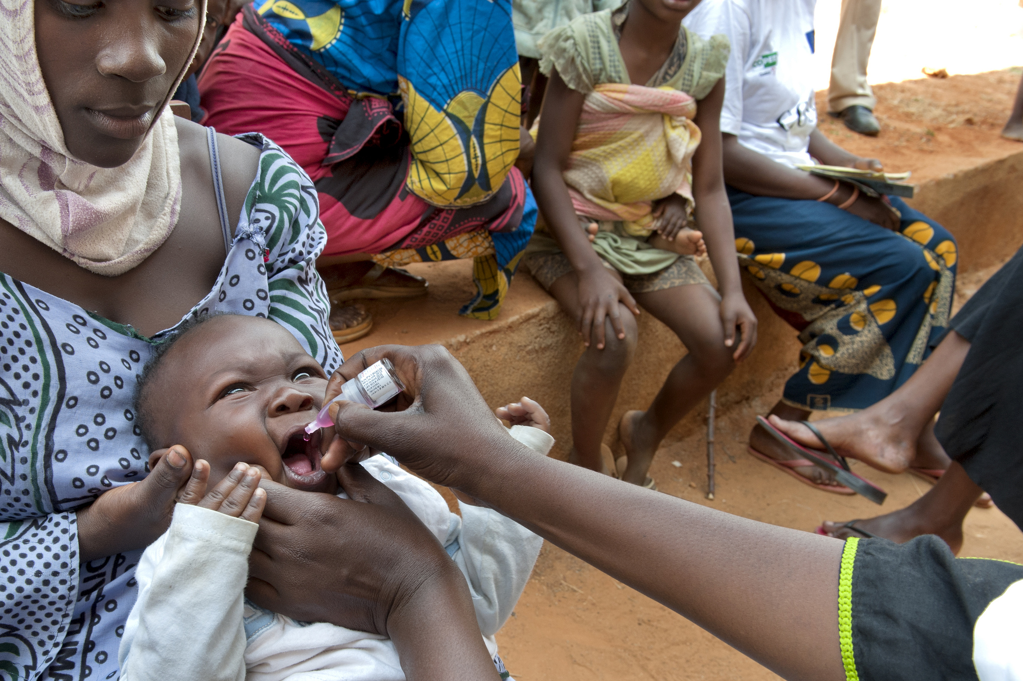 GAVI workers administer vaccines to children in Burundi. 2013 [Ken Opprann/Norad/Flickr]