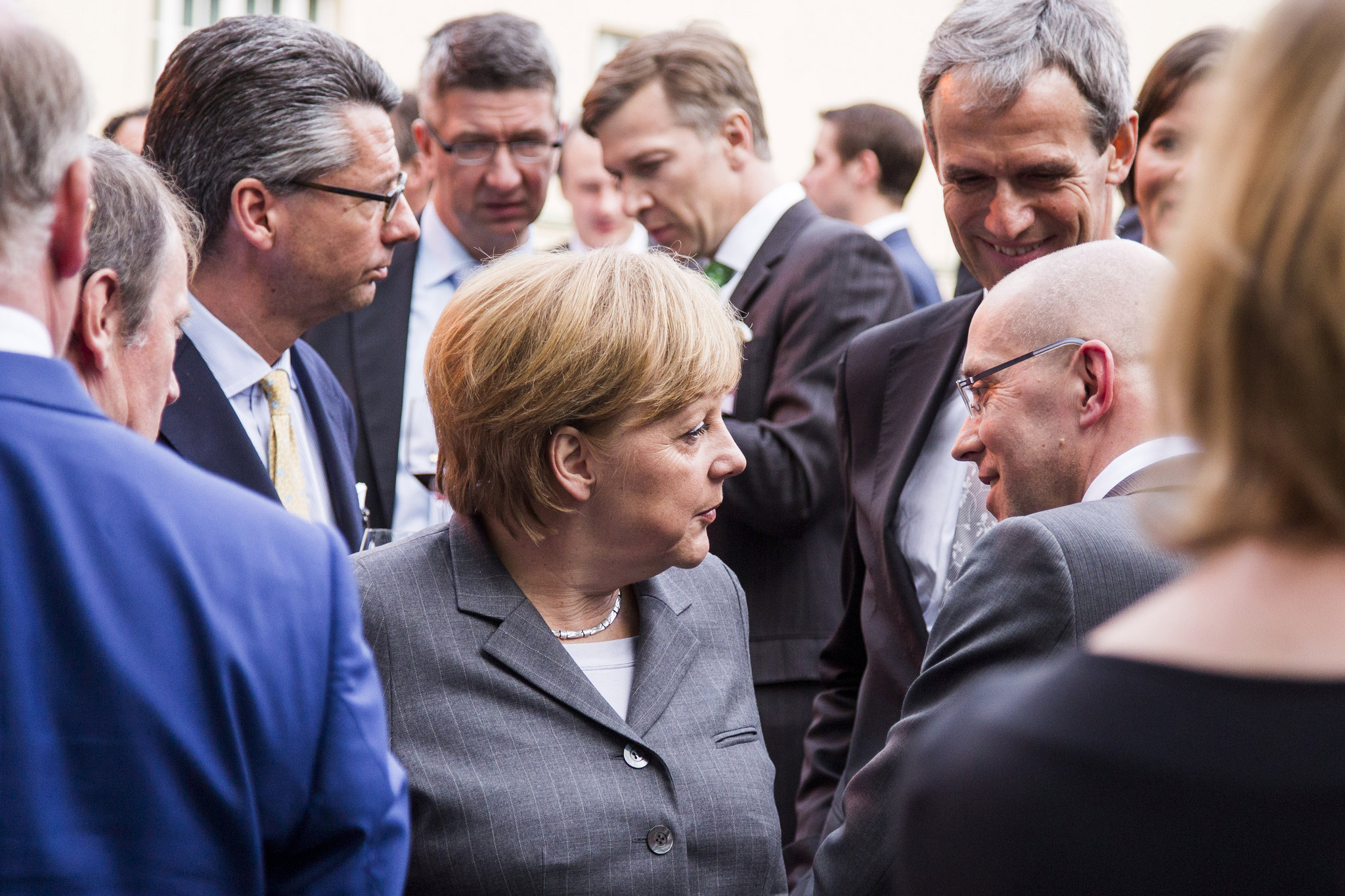 """When is the right time, if not now?"" German Chancellor Angela Merkel said on Tuesday, referring to US-EU trade deal, TTIP. Here, she is pictured at an event with BDI chief Ulrich Grillo (left) in 2013. [Jochen Zick, Action Press/Flickr]"