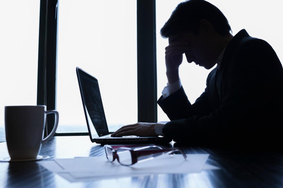 An overworked executive [Shutterstock]