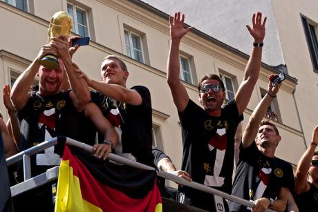 The German national football team is welcomed home by fans in Berlin. 2014 [Markus Winkler]