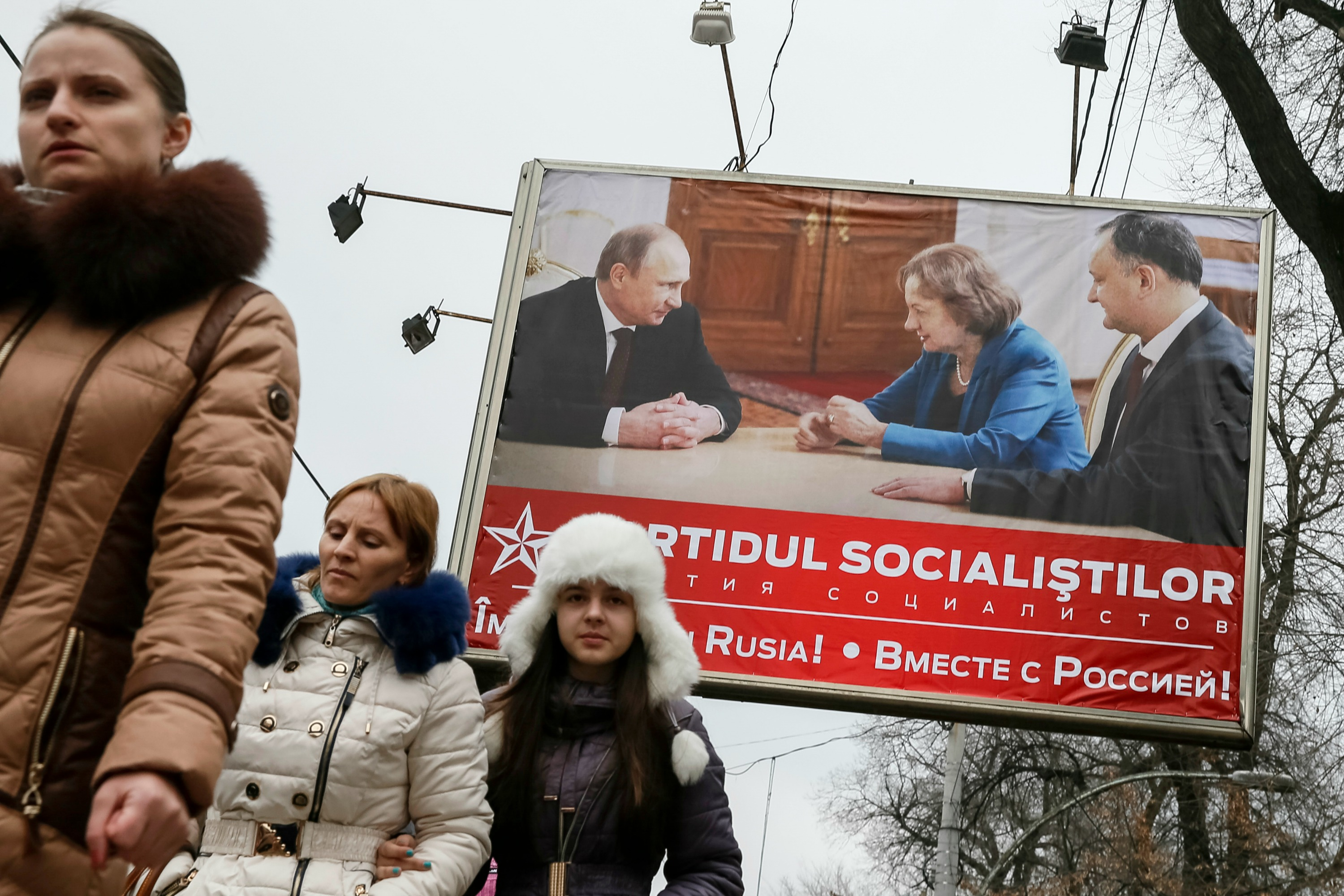 "Socialist Party election poster depicts activists meeting with Putin. It reads ""Together with Russia"" [Reuters]"