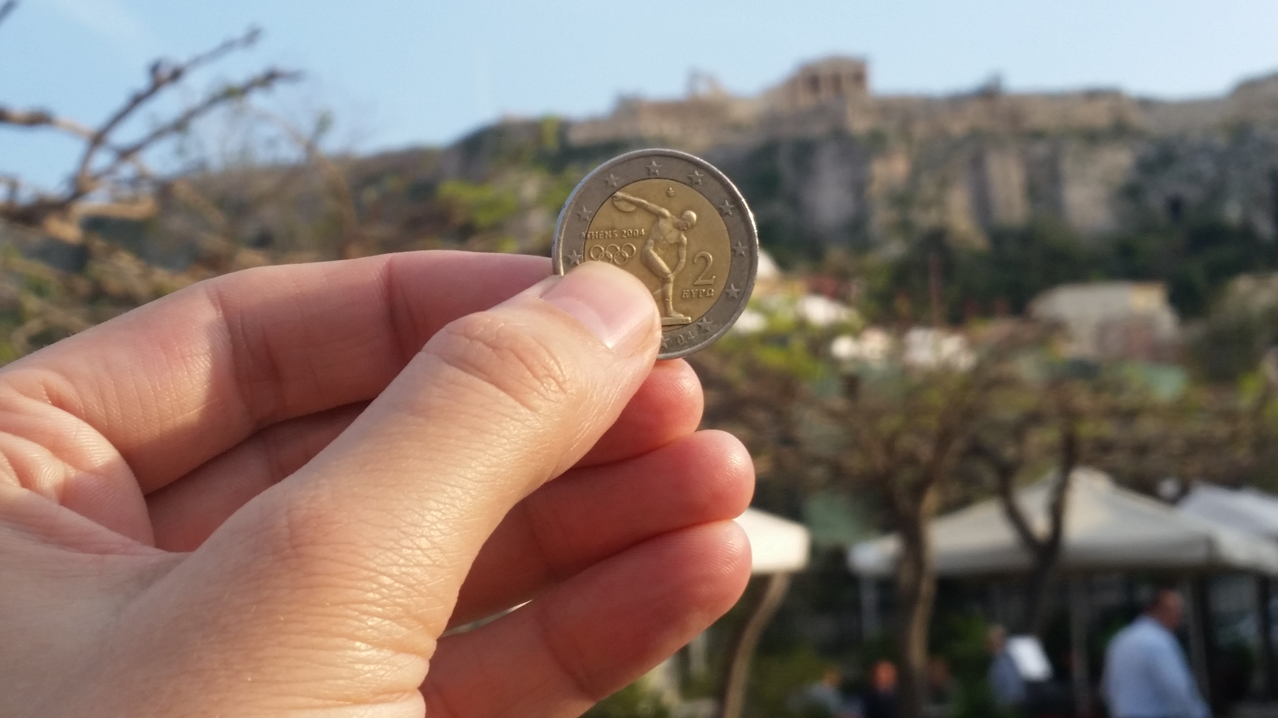 A two Euro coin in front of the Acropolis, Greece