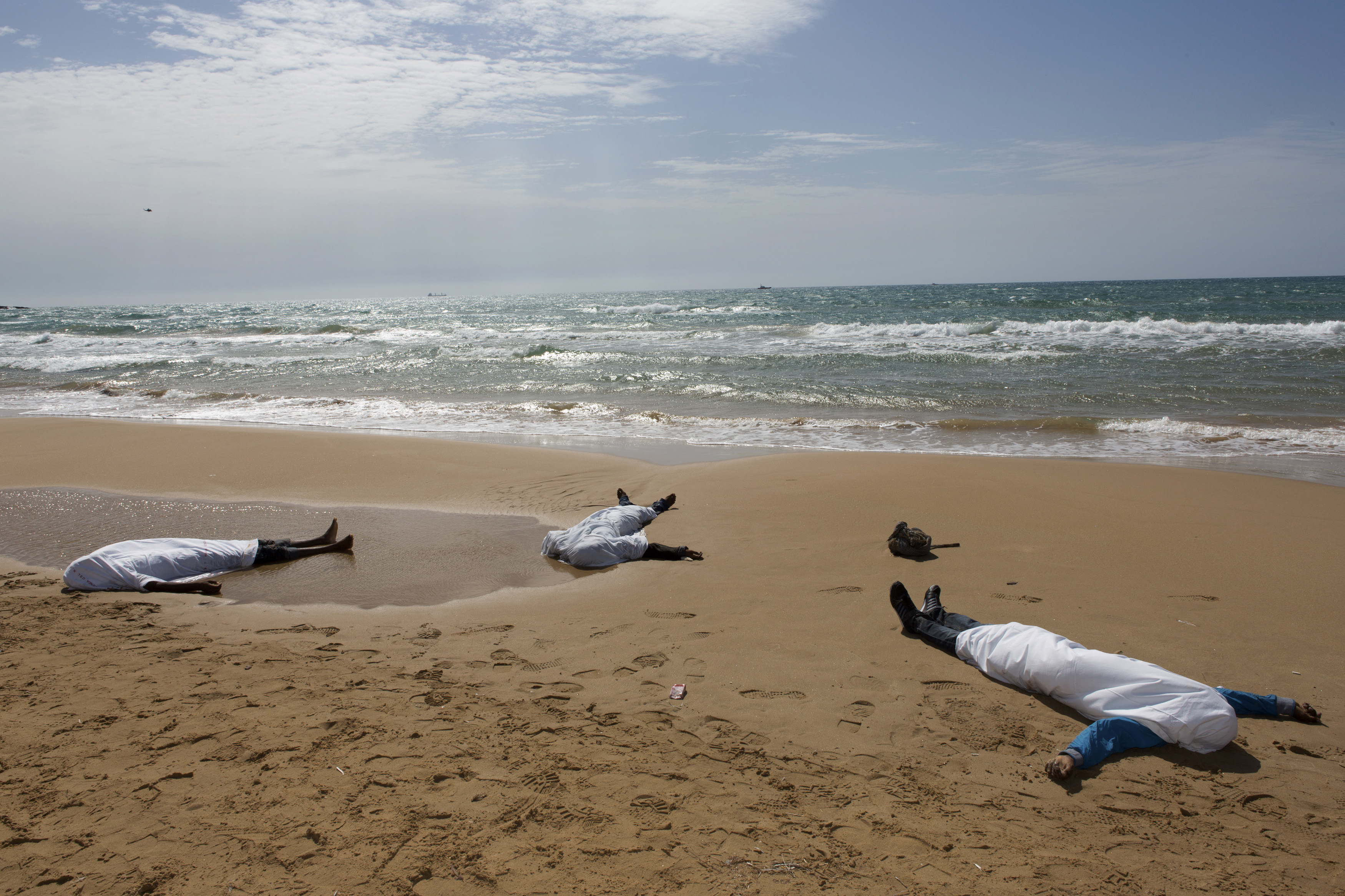 Dead immigrants on Italian shore, file photo [Reuters]
