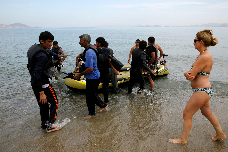 http://hrvatskifokus-2021.ga/wp-content/uploads/2018/05/spanish_tourist_watches_immigrants_arrive_at_island_of_kos-scaled.jpeg