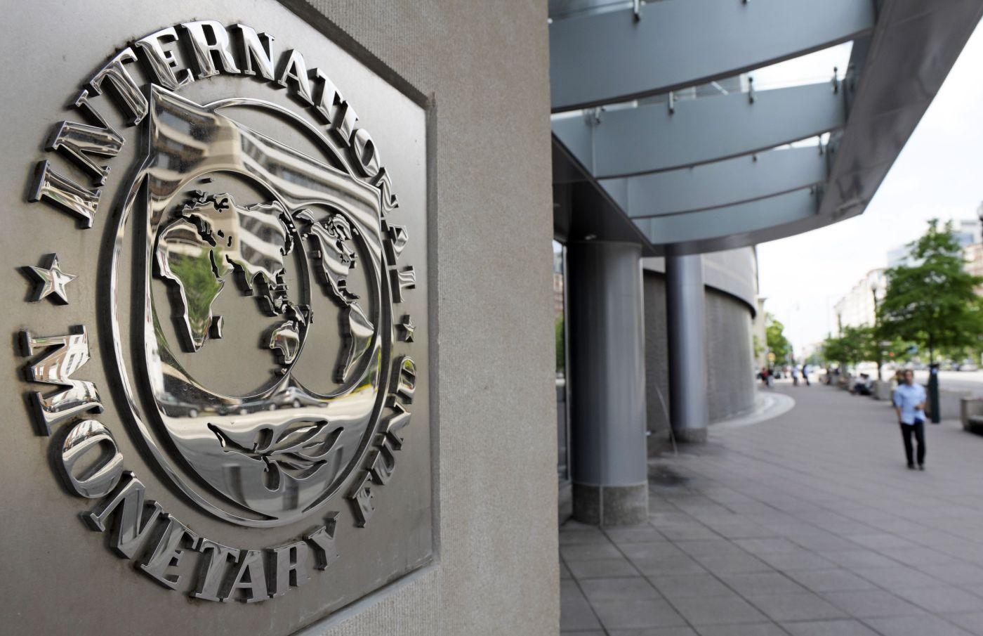 Pedestrians Walk Past The International Monetary Fund Headquarters Complex In Washington