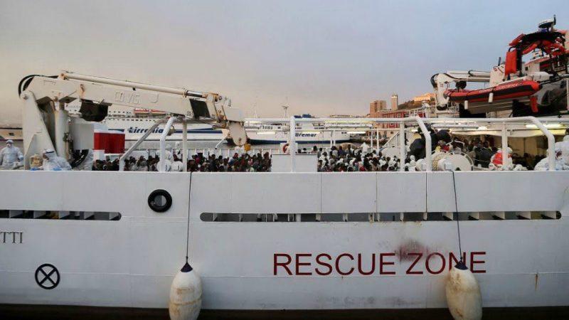 Dozens of migrants still stuck on coastguard vessel in Italy port