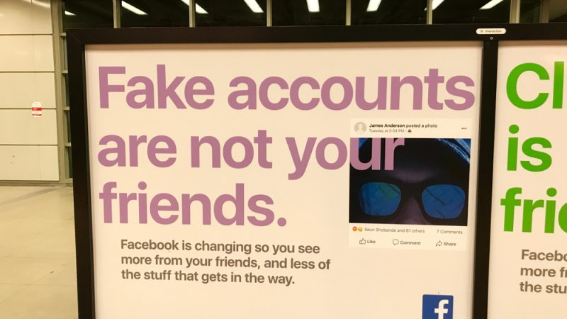 Facebook billboard in the Chicago airport reminding people to watch out for fake accounts. Facebook have accused Russia of propagating disinformation to the EU and the West.