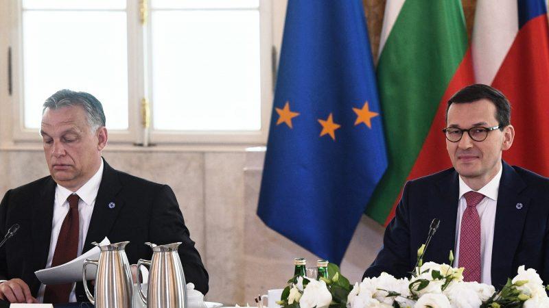 Polish PM threatens to veto budget in call to Merkel
