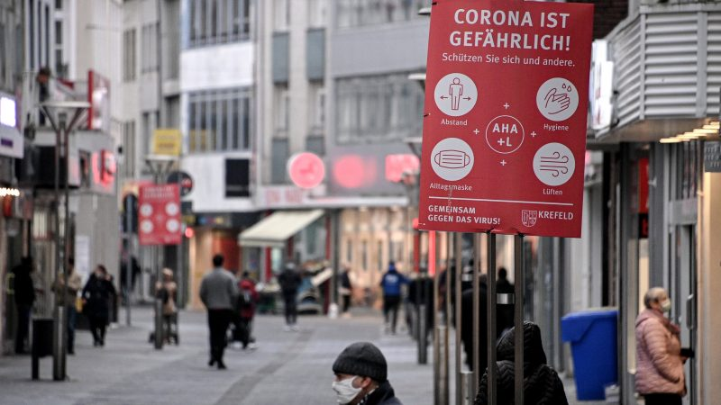A sign 'Corona is dangerous' is seen in the city centre of Krefeld Germany 4 January 2021