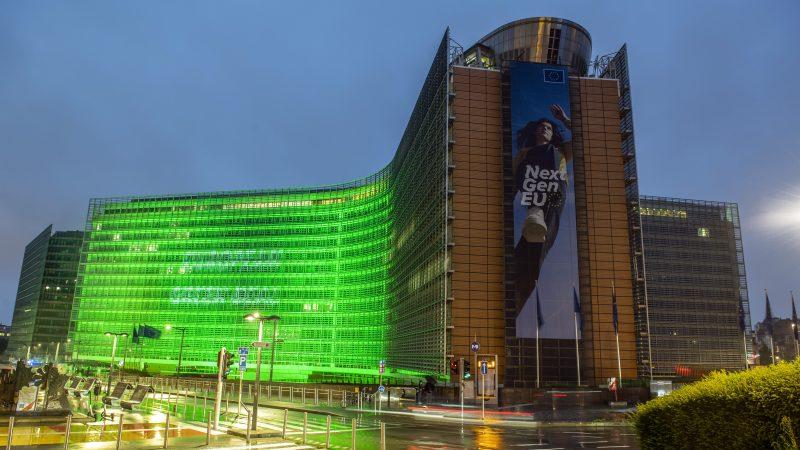 The Berlaymont building lit in green